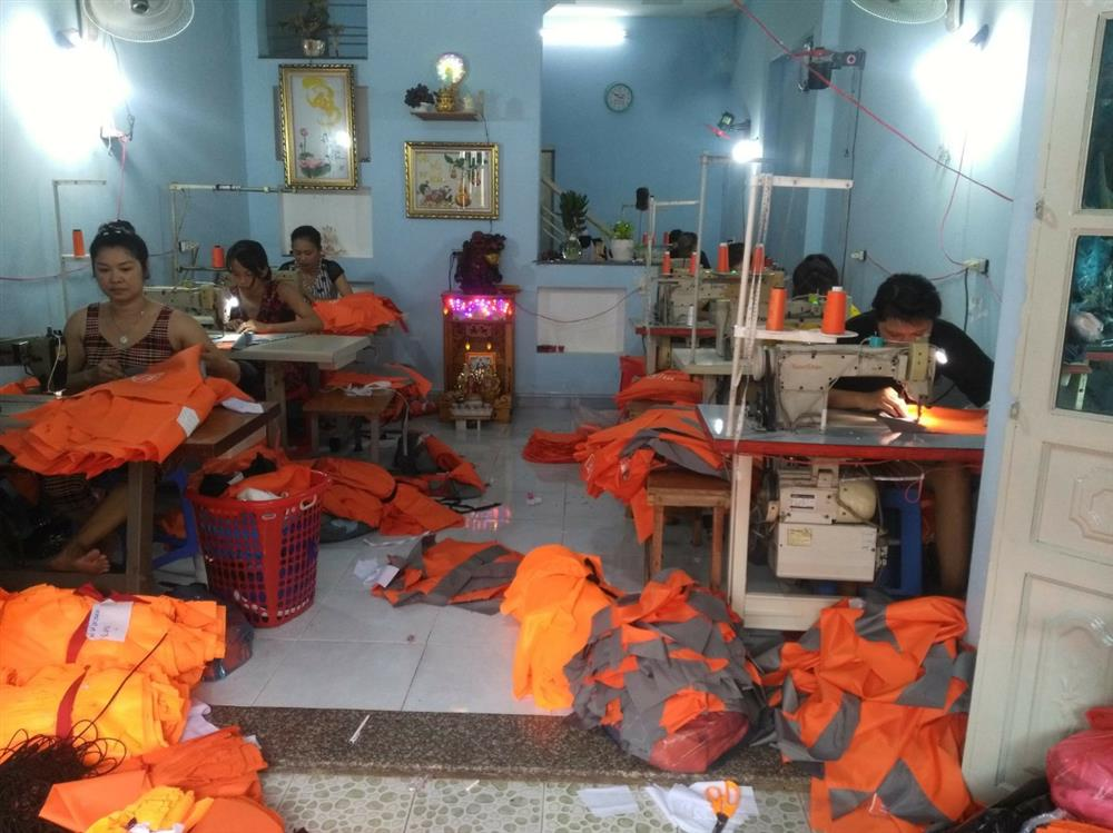 xưởng may áo gió limac